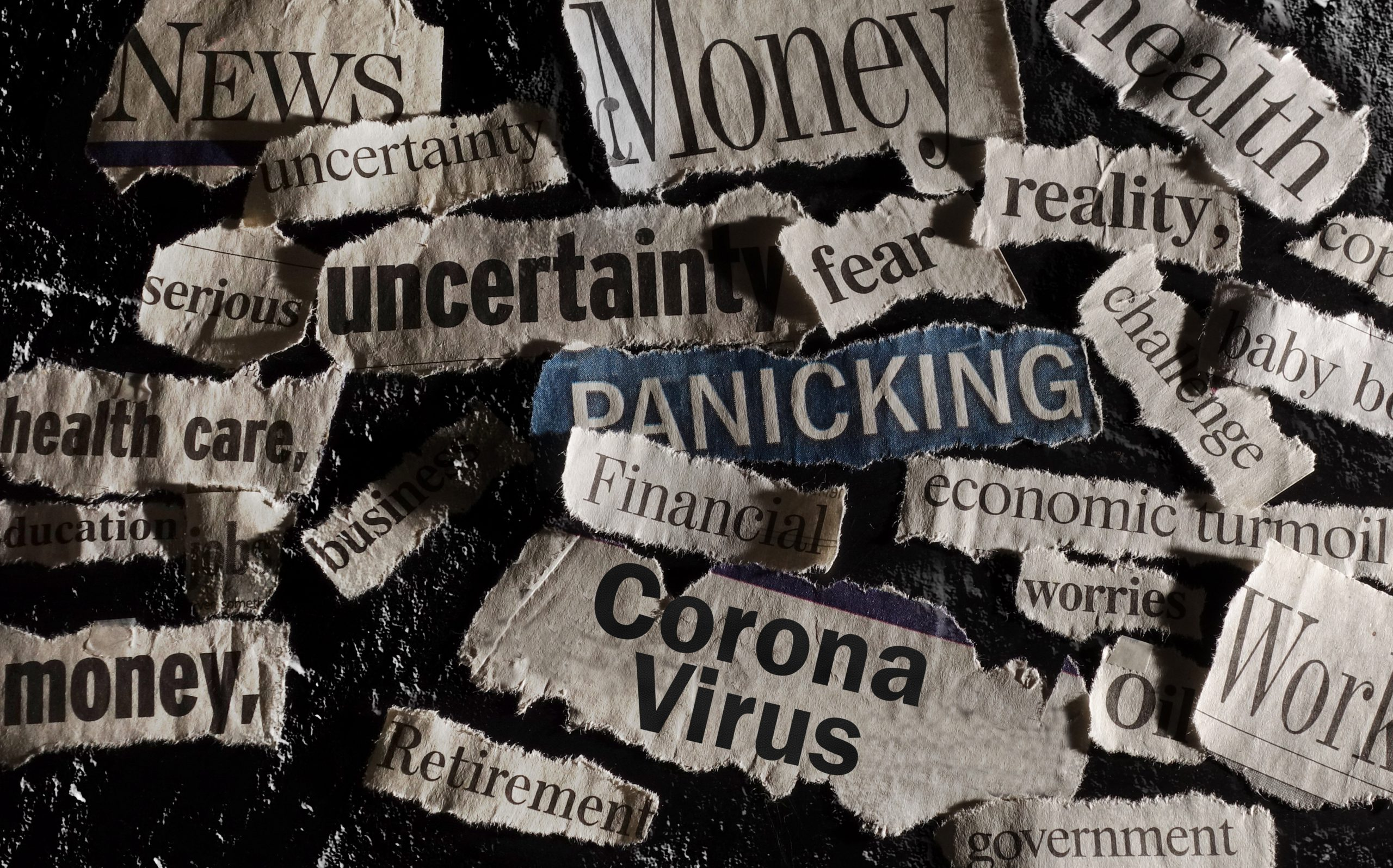 Various newspaper headlines with words depicting worry and uncertainty